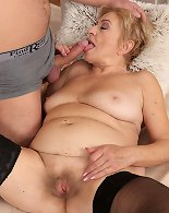Blonde mature tries young cock in her creamy vagina