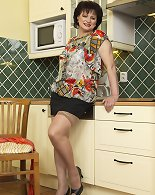 This curvy housewife loves in the kitchen