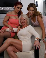 Two cougar asses playing with a young tanned doll